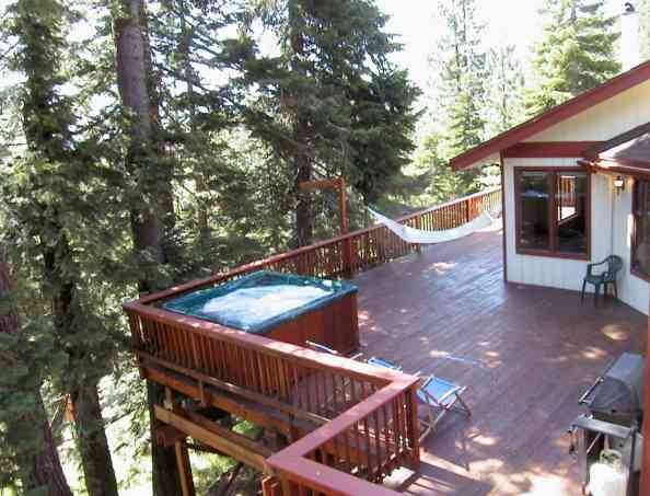Entertain your guests with private hot tub spa, pool table, 1,000 square feet of beautiful redwood decks, views of Heavenly Ski Area and several mountain ranges, National Forest adjacent to your backyard, wood stove, cable TV, jacuzzi air jet tub, wood paneling and fun open floor plan.